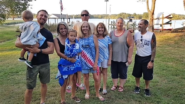 Ann's 80th Birthday, with her family, left to right:<br /> Michael Coppa, holding Carter, Kelsey Coppa and Kinsley Coppa, then Kathi Russell, with Dennis behind her, Ann, then Laura Harding and Anns son Tom at the end.