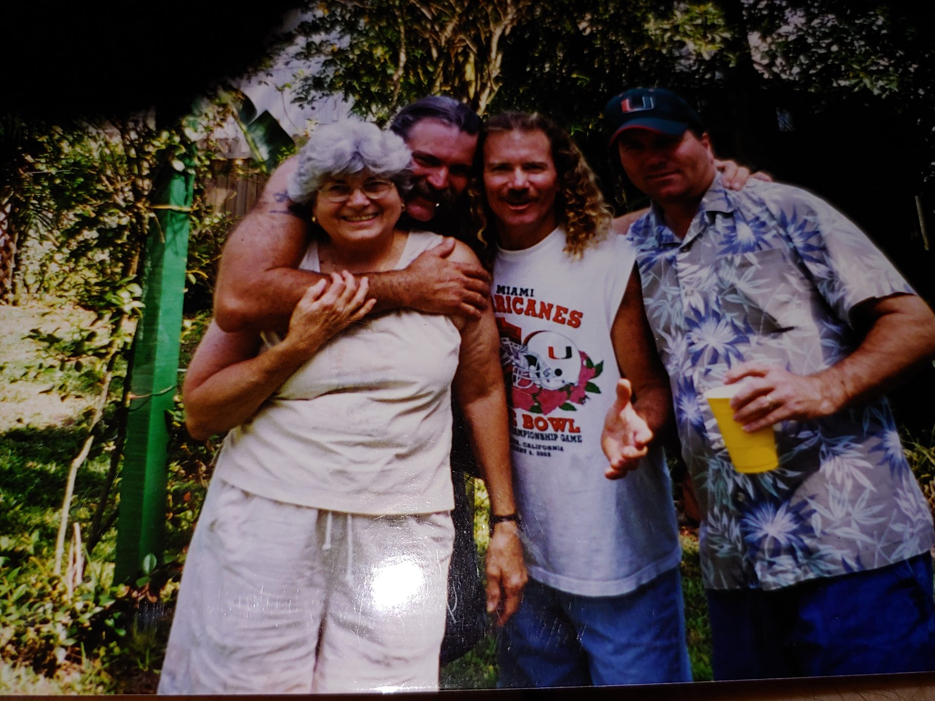 Dean hugging mom with Todd and Mike