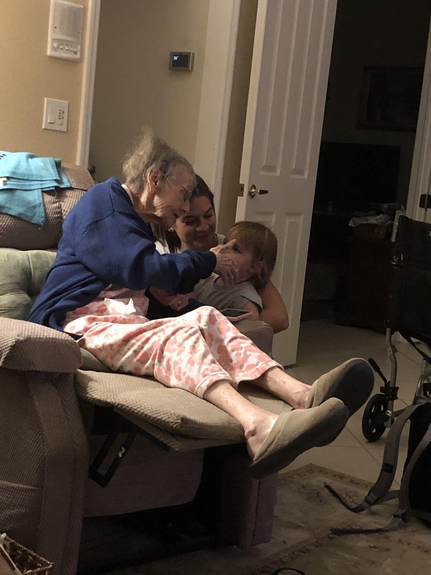 Great Granddaughter listening to Mom