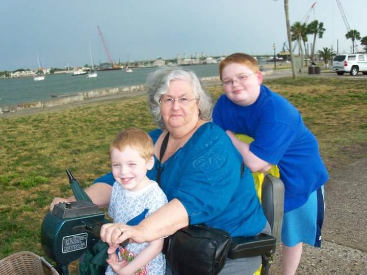 Nan with Chase and John Dolphin watching in St. Augustine