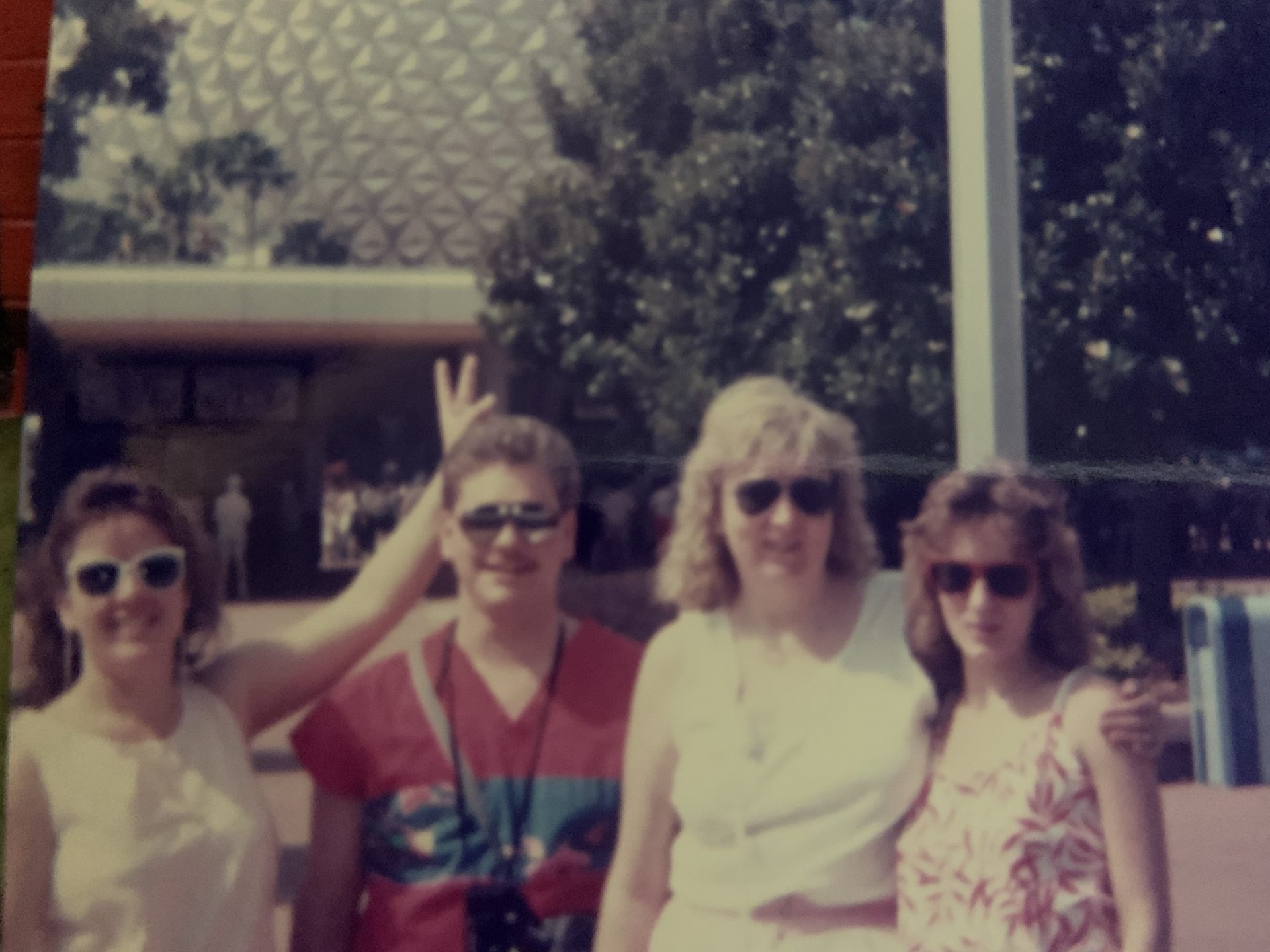 Mom with Tammy, (daughter) Tom and Dawn at Disney