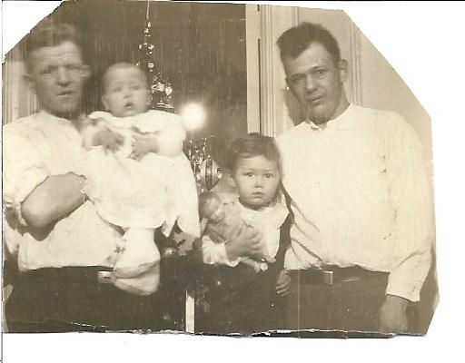 Sylvia with her brother Ralph, her father John and her Uncle Aage.   <br /> <br />