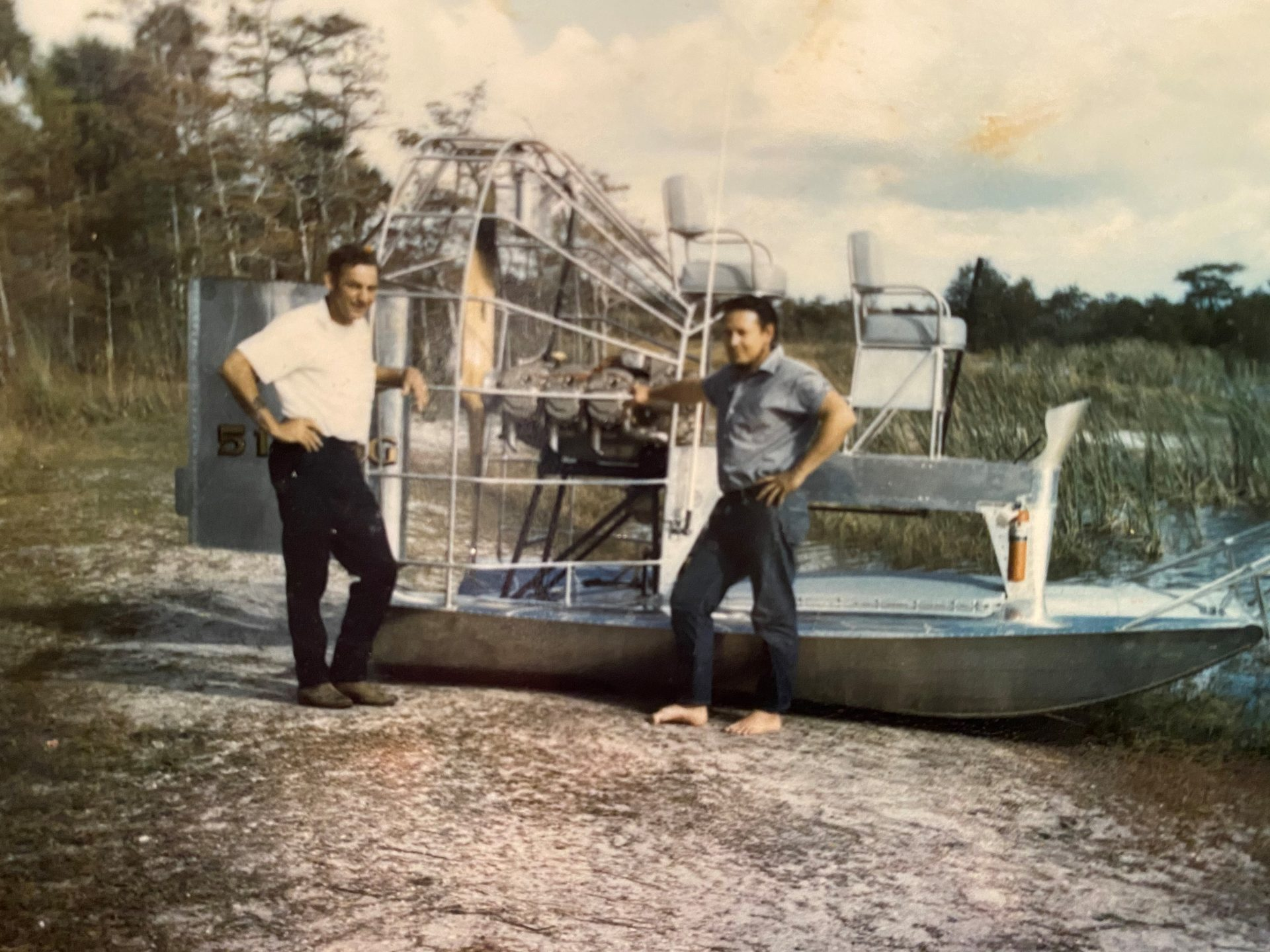 Bobby and ?   Airboat on berm