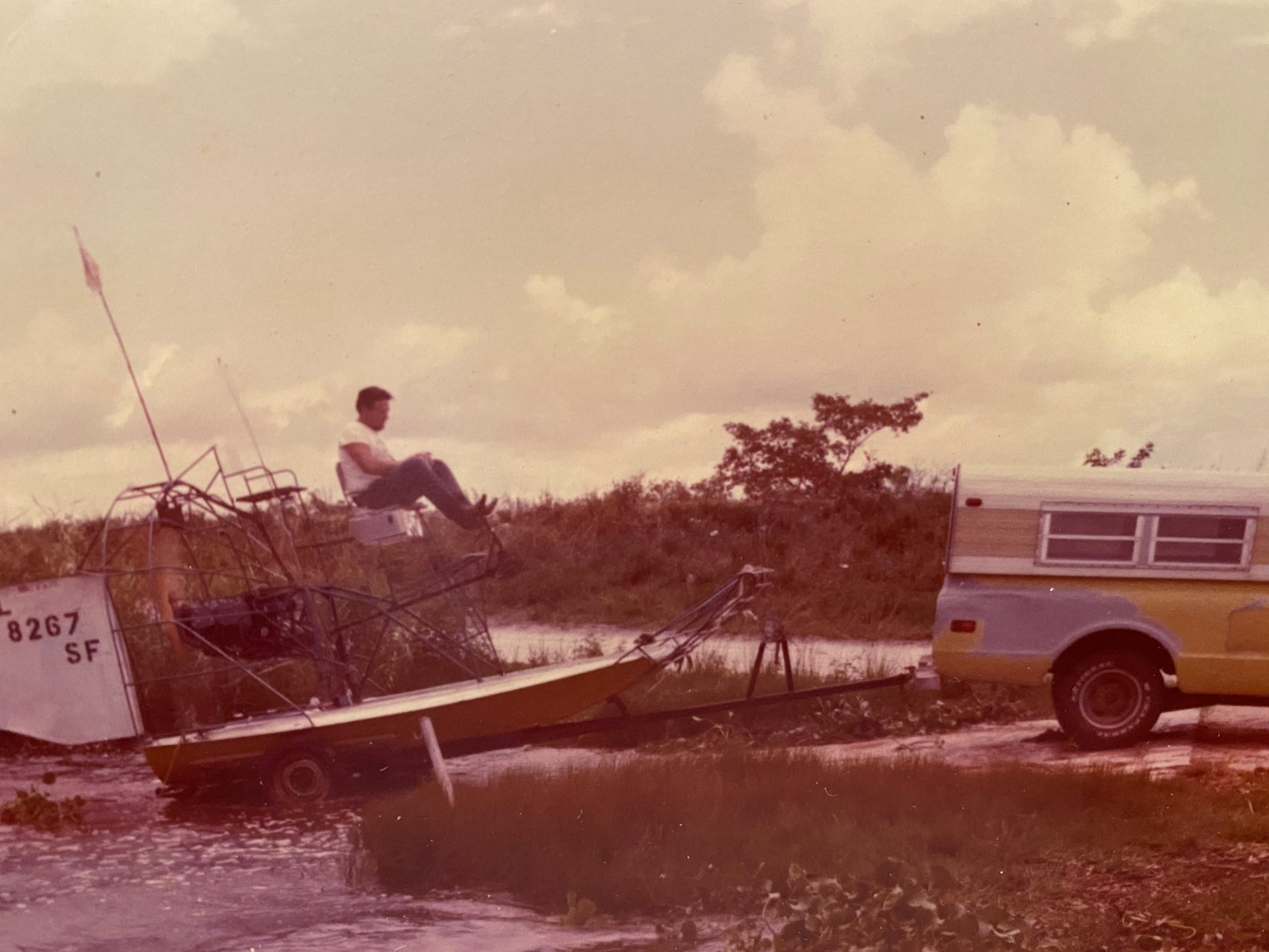 Bobby loading yellow airboat on the trailer