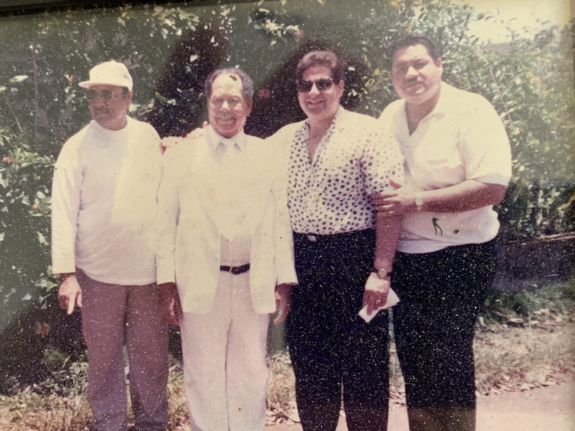 Hey brother Lee. Here we are the Perez clan. Santos, Papi, me and you.  RIP my brother.
