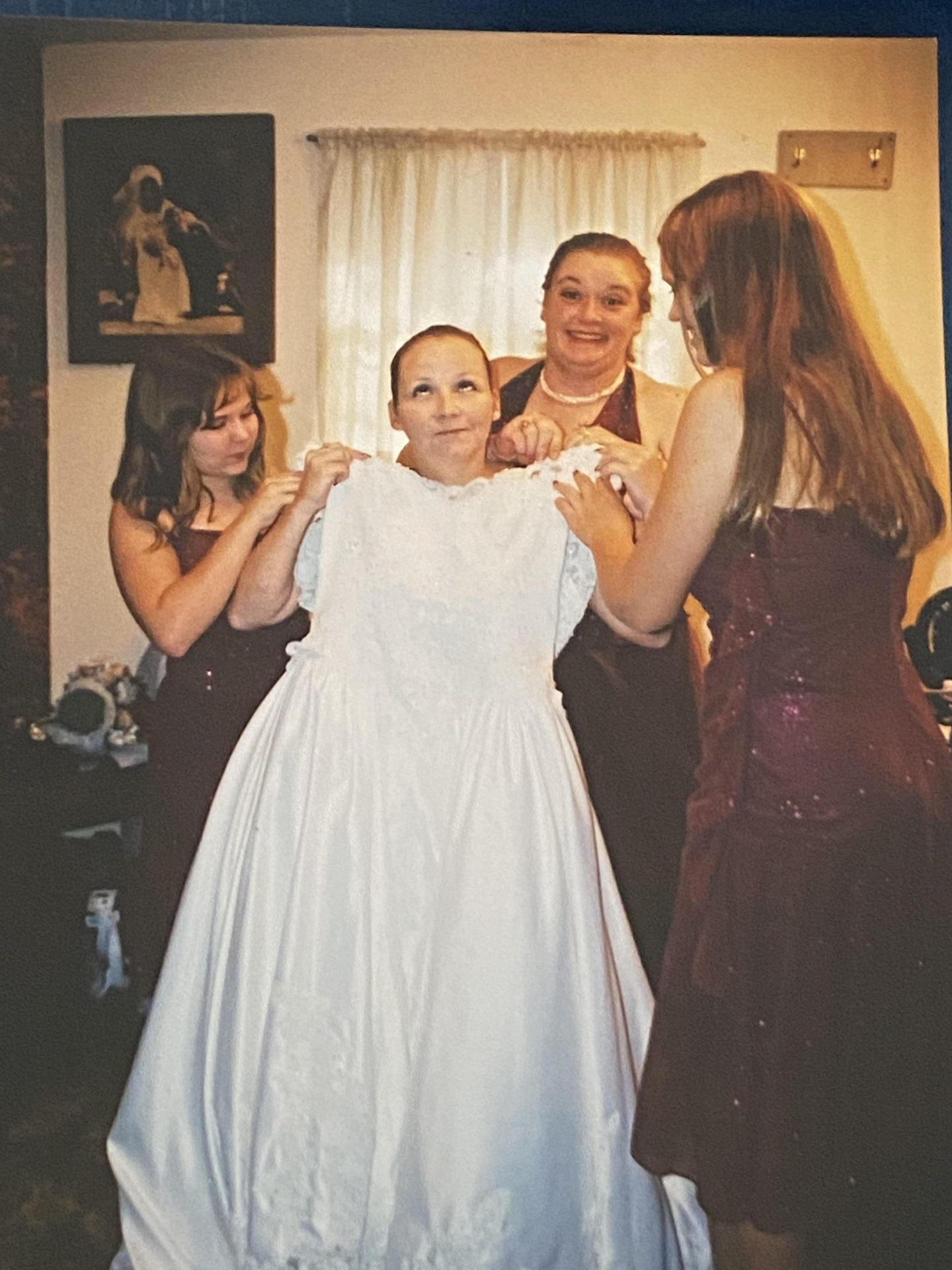 Getting into her wedding dress