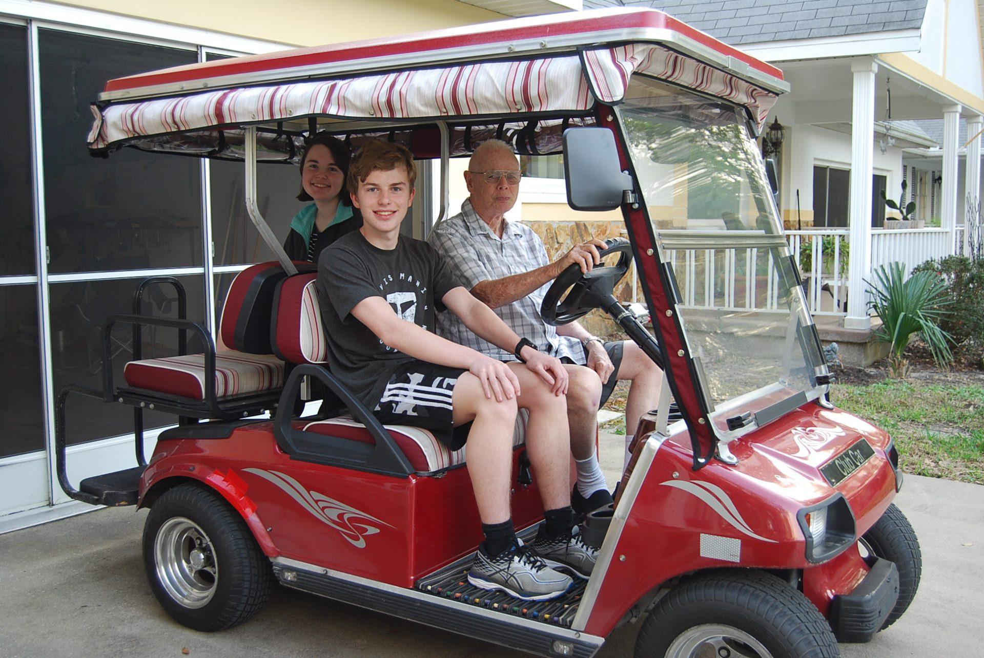 Having fun on Grandpa's golf cart