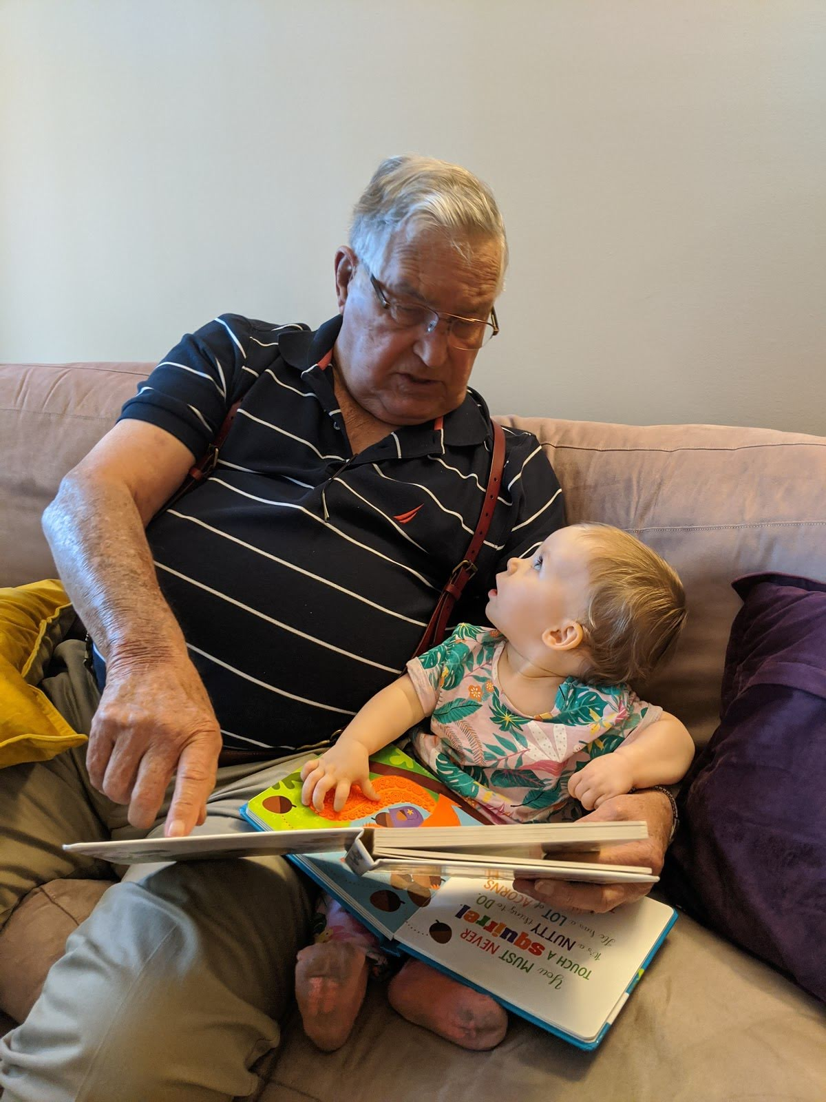 Dad (Pap Chuck) reading to Maeve his great granddaughter. <br /> Barbara