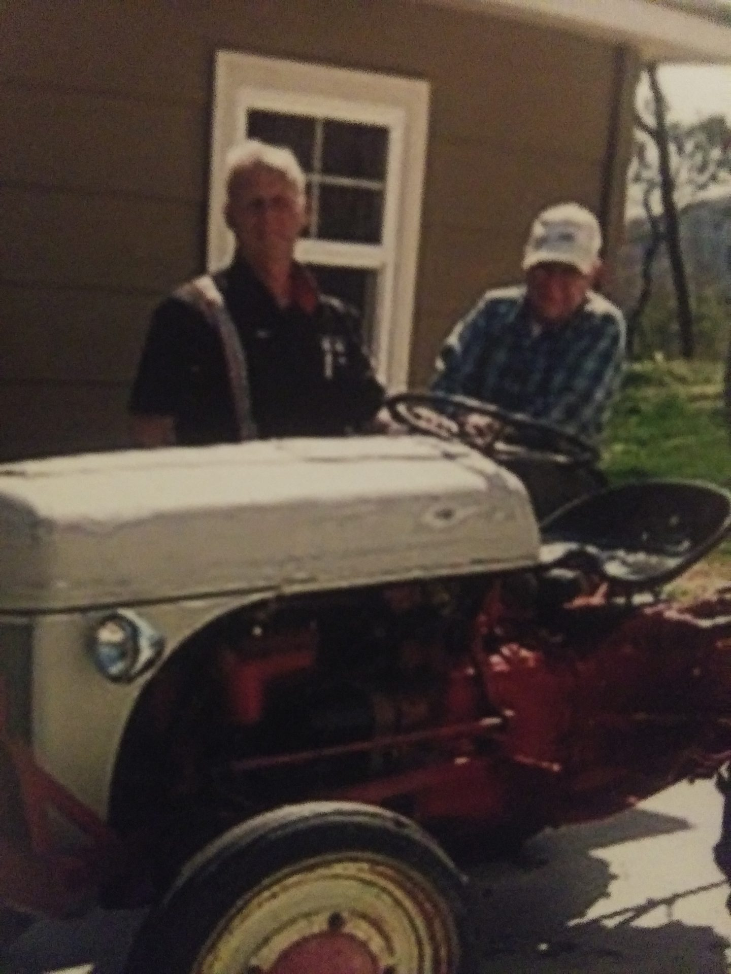Dad and Joe working on antique tractor