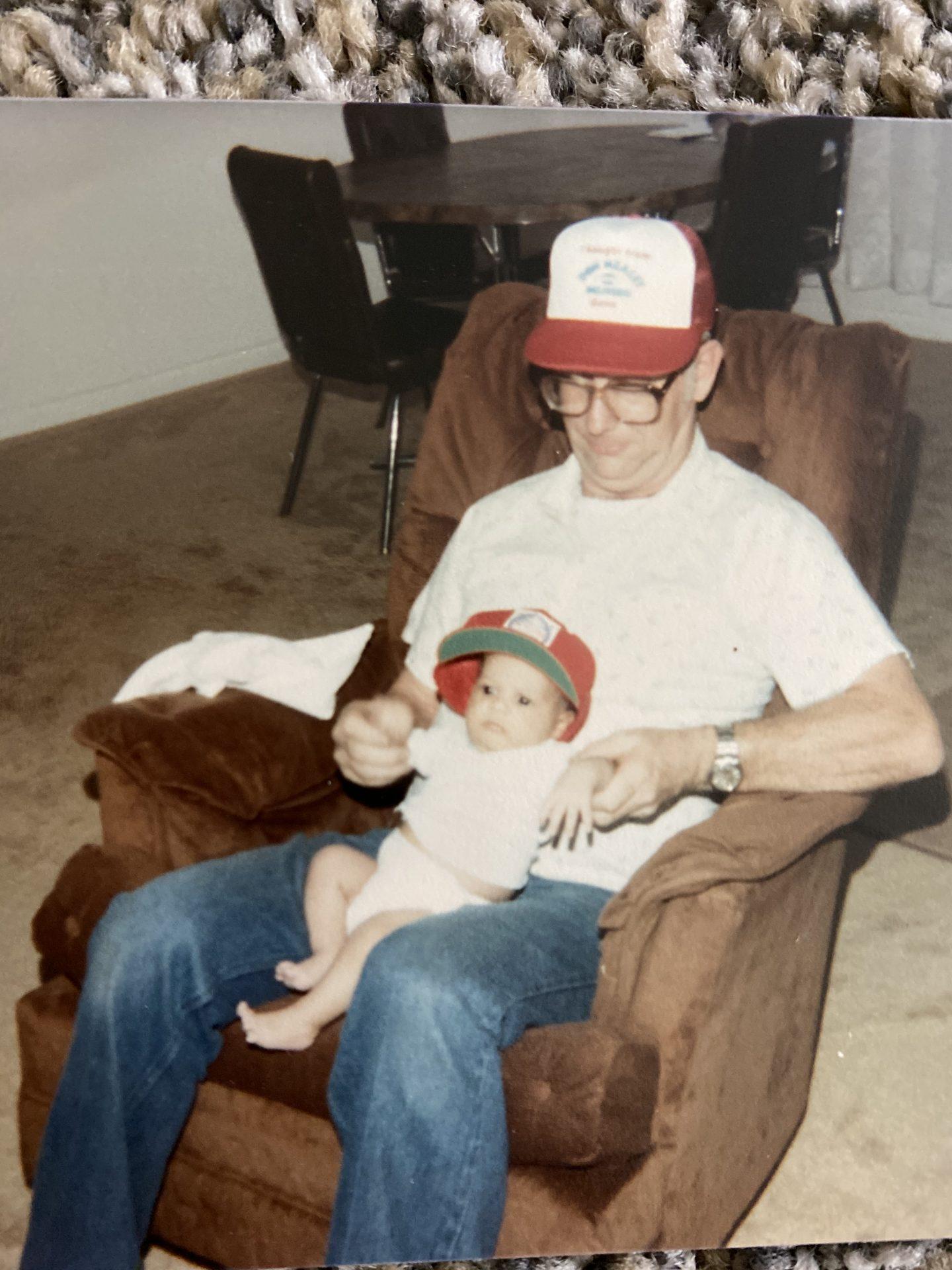 Papa gave Sean (his bean head) his first baseball hat..