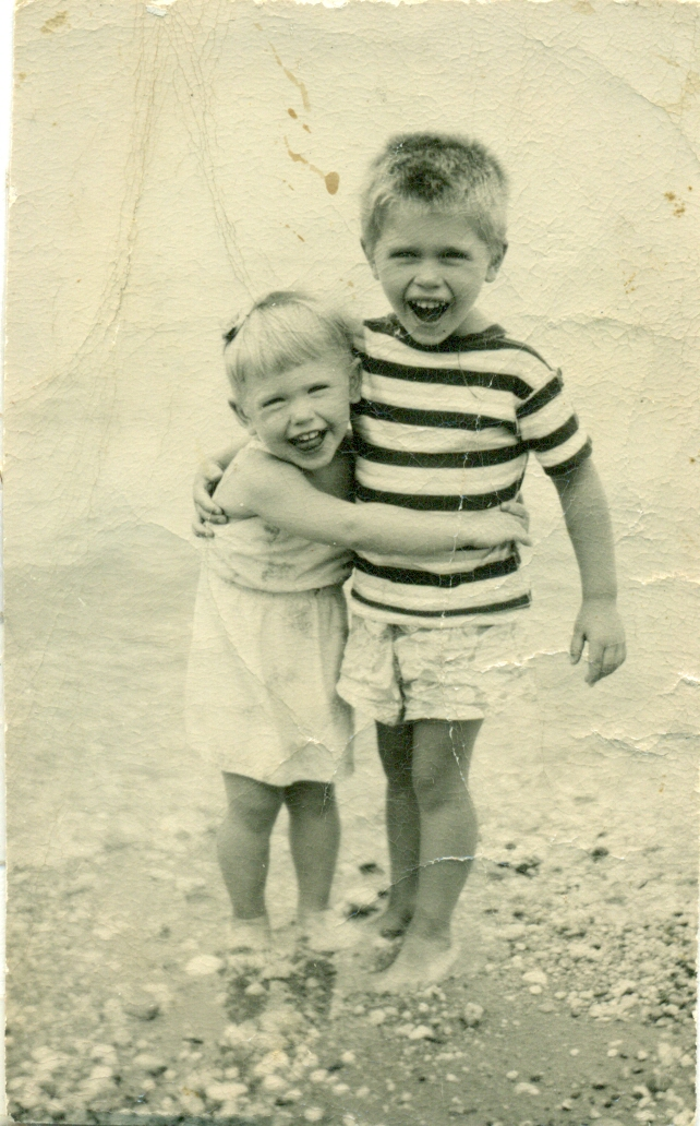 Brother and sister at the beach.