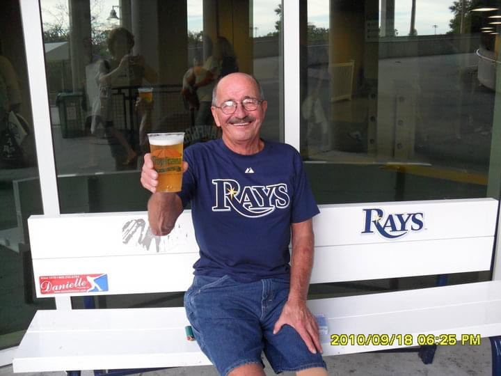 All smiles with baseball and beer