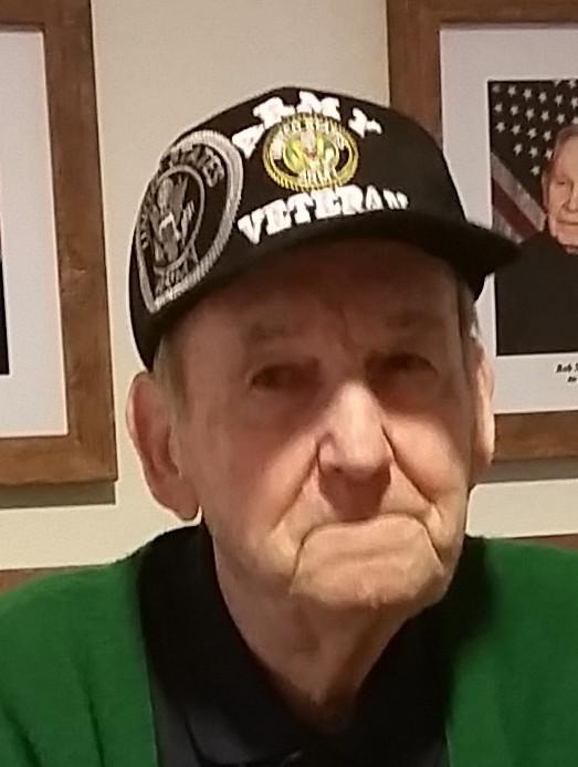 Karl Dorsett in veteran's cap.