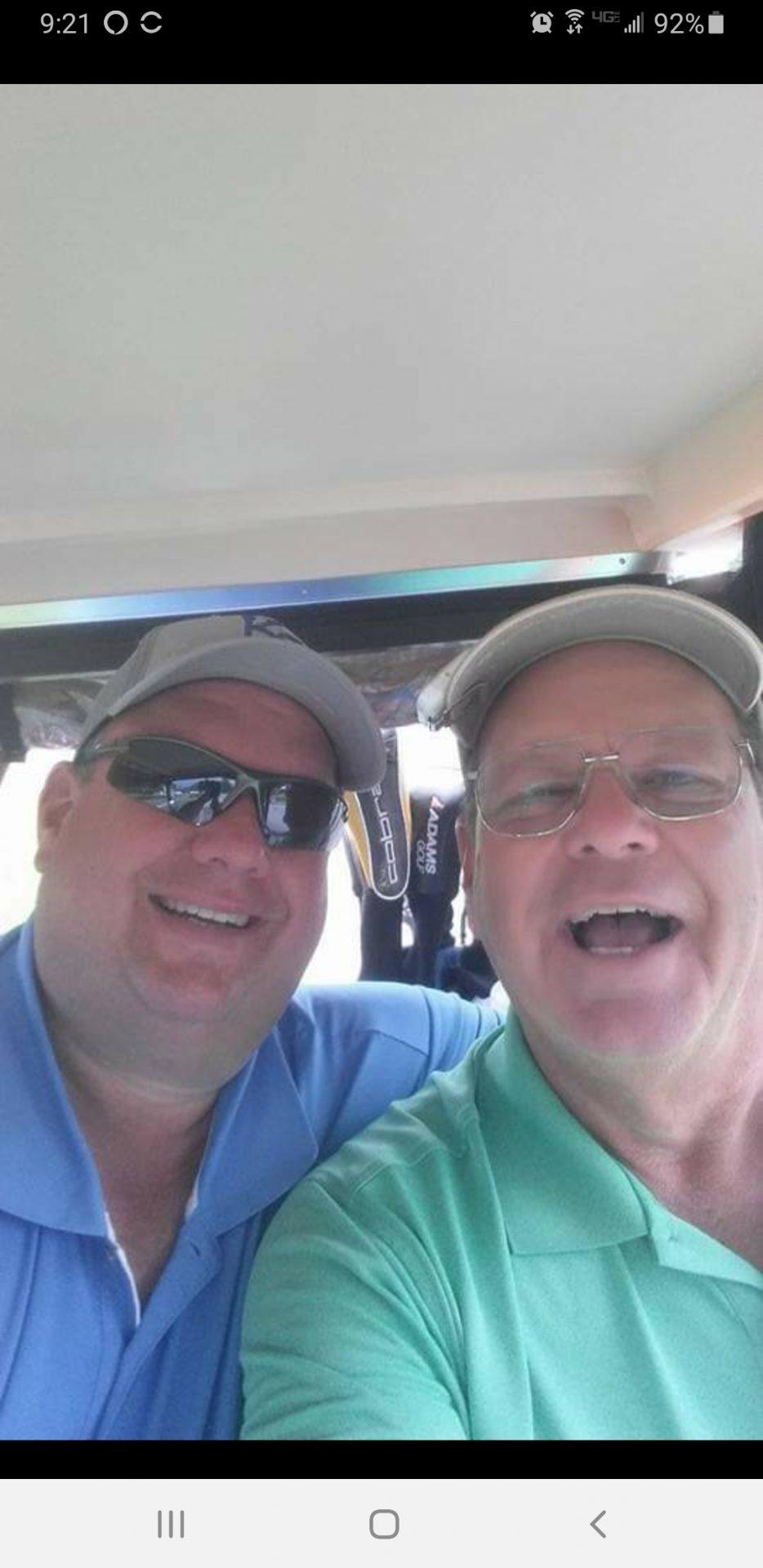 Byron jr and Byron golfing