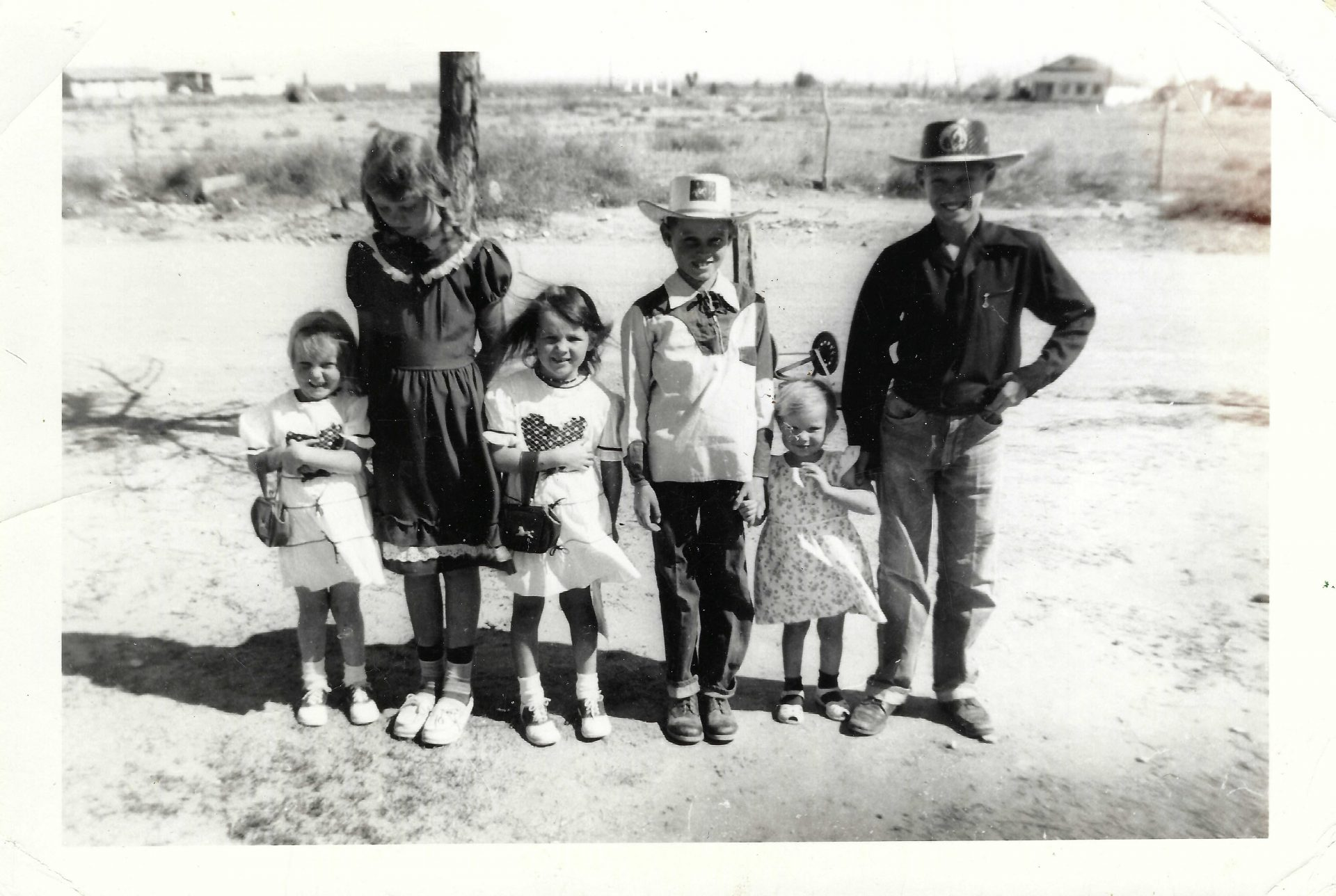 """""""Reaching out, touching you touching me"""" Will, the ideal Brother<br /> Wilcox children, 1950's.  Iris, Alva, Norma, Will (holding my hand), Nita, Elton"""
