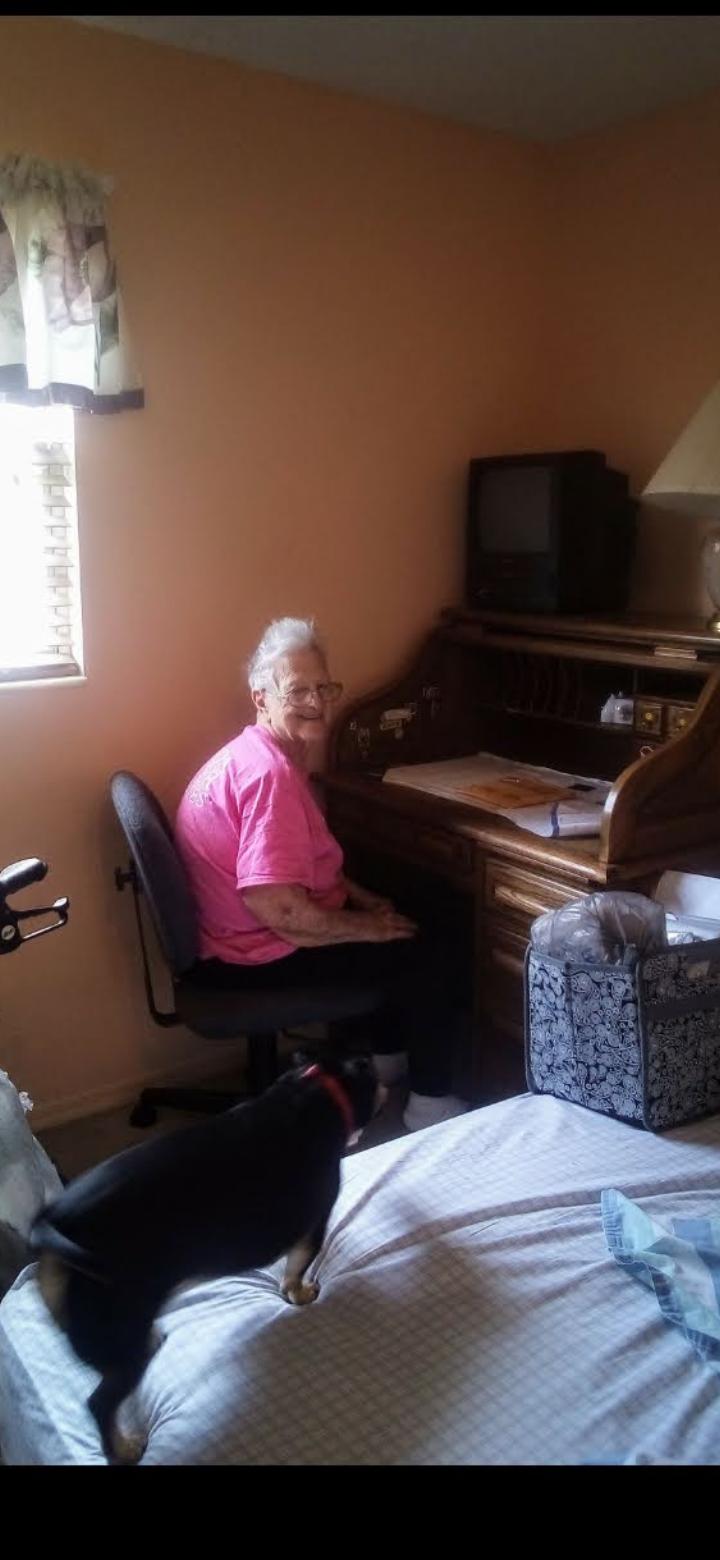 Mom at her desk.