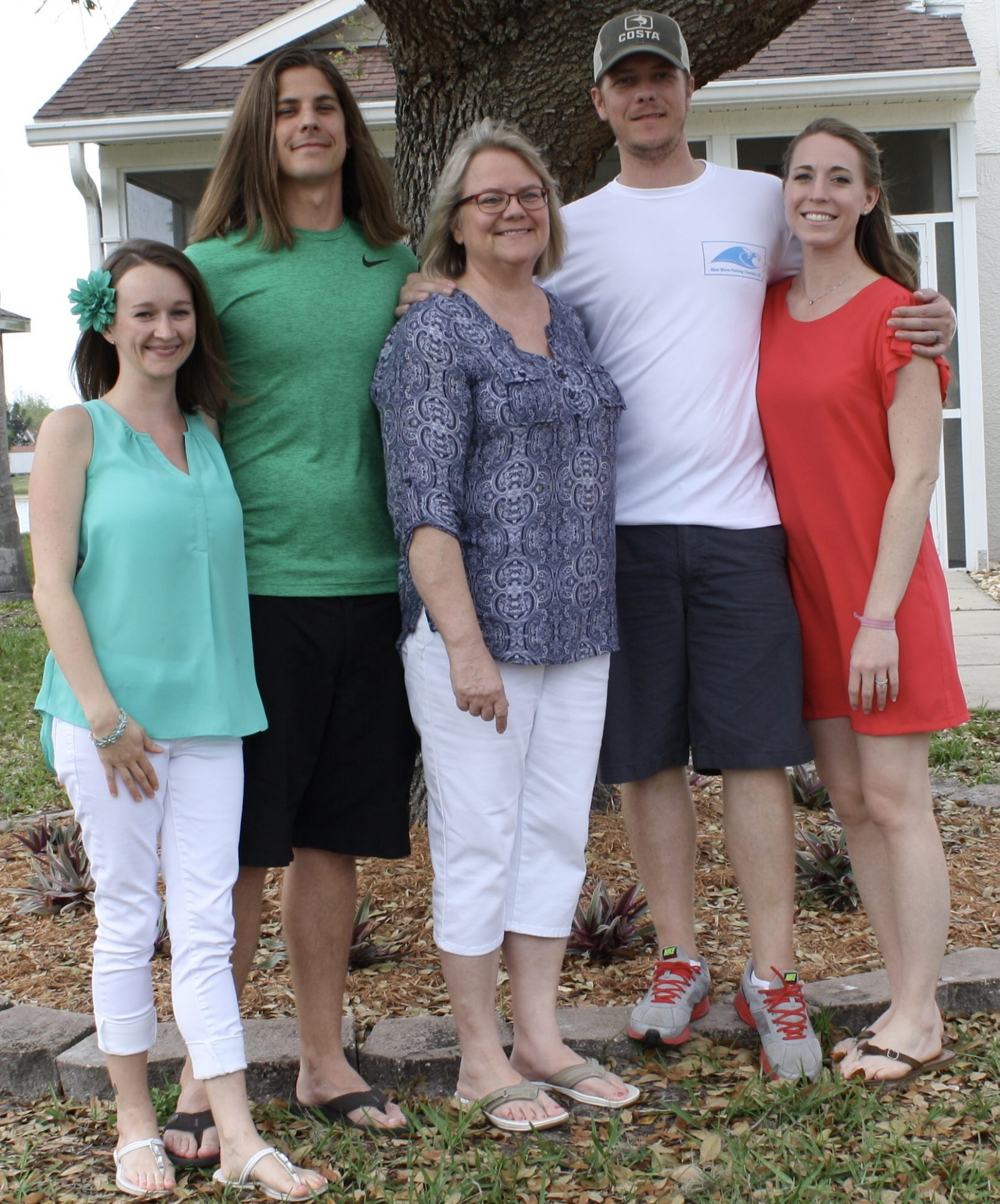 Joyce's daughter Margo and grandsons/wives, Andrew and Sarah, Corey and Holly.