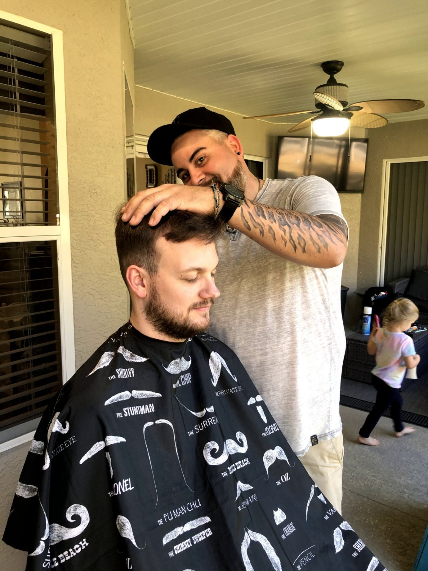 Brent demonstrating his hair cutting skills on Taylor