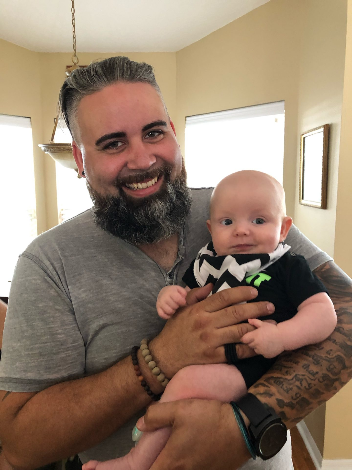 Jaxon meeting his cousin Brent for the first time He was a natural with babies!