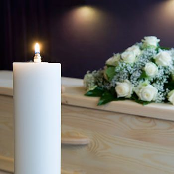 orlando cremation package picture with candle and roses
