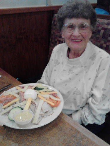Oct 2011: Grandma Dawson eating one of her favorite things, a big salad with chicken and honey mustard dressing!