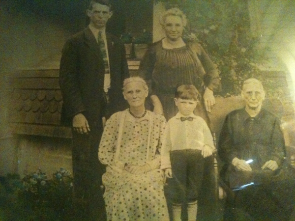 The little boy is Boyd, Tall man is Lyman Shreve, the rest are Boyd's grandparents  and a great grandparent.