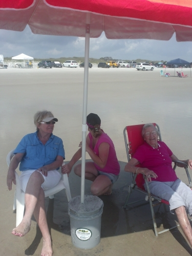 mom at the beach with Pat & Emily