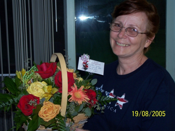 Carol with Anniversary Flowers